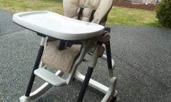 Peg Perego Prima High Chair. Rocks and adjusts to various heights to grow with the age of the child. 5 point harness. Brakes on wheels and easy to fold up.Overall in excellent condition with only some wearing to the base of the seat. If you want a
