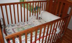 FOR SALE: OAK BABY CRIB. PERFECT CONDITION, INCLUDING THE MATTRESS IN THE SALE. CALL: 819-770-7103