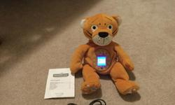 Photokinz Rocket the Tiger. Excellent condition. Stuffed tiger with digital photo frame tummy. Load photos onto the screen and great for child or anyone really to carry photos around with them. $25.00. Lakeridge pickup. No holds. Posted on other sites