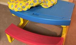 Playskool plastic picnic table with flip-up compartments for storage. Never used outside, great condition. Sturdy. Excellent for an arts & crafts table, etc. Smoke & pet-free home. Custom-made material cover included. Pick-up in Barrhaven.