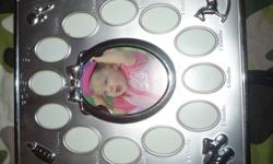 brand new picture frame. month of baby 10.00. and a worlds best dad metal with case 5.00