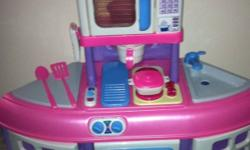 pink kitchen play set for your little one.. it comes with accesories.. it lights up and make sound! will entertain your toddler for sure!