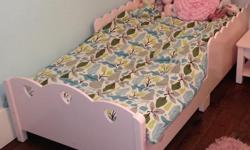 This sweet little pink bed fits a crib mattress. Just the bed is for sale, not the mattress or bedding. Asking $30 OBO. Pick ups only please.