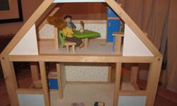 dolls house with some accessories, could use some area rugs :).