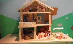 Includes everything shown: * Terrace house * Master bedroom * Children's bedroom * Nursery * Kitchen * Living room * Dining room * Bathroom * Patio furniture. * Family - 4 dolls Made from natural rubber wood trees and without the use of chemicals in the