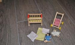 Comes with crib stroller and two wooden babies. I think one is from a hape set and the other is plan toys.