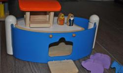 Noah's ark, with removable parts on top and door which opens and closes, lots of little animals. We are missing the second crocodile, otherwise complete and in great shape. I have other plan toys for sale you can check out my other ads.