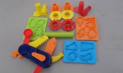 Play Doh accessories including shape presses and a swiss play doh knife!  Like new