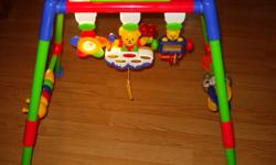 caterpillar that pulls apart on one side. on top section flower shaped rattle, little mirror on the other side, little bear playing the drums in the middle. drums light up different colours and sing when string is pulled. can be taken apart for storage.