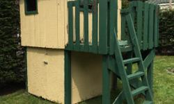 Cute playhouse with storage area. Ready for you to pick up.