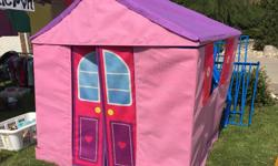 New: $100 from Sears Fabric-covered cardboard (thin wood?). 3 walled house with 2 open windows, roof and 2 swinging doors. Colour-coded Velcro to assemble. Reasonably simple. Best if built in the corner of a room. My kids loved it!!
