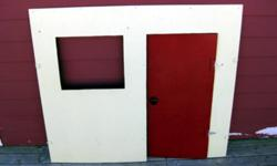 3 panels for a kid's playhouse. plywood. front panel has hinge door and a window with a curtain rod on back. activity panel on inside. 2 side panels have windows with working shutters. I had it attached to an old wooden table to make the house, otherwise