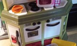 Awesome play kitchen with sizzling burner sounds. EUC. I'm including all the play food, dishes and microwave that we purchased separately.