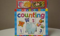 Preschool Simple text and shaded areas guide children to place the missing magnetic animals and numbers correctly. Like new.