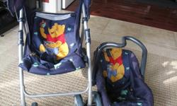 Play stroller with baby carrier.  Winnie the Pooh theme.  Great condition.