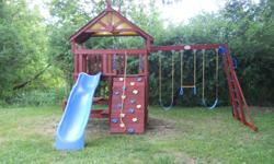 Sunray Cedar Premium Play structure bought at Costco in 2006 ( $1800.00) . In storage the last 4 years. I have the owners manual and parts identification guide. Newly stained. Includes, slide, rock climbing wall with rope, climbing ladder, picnic table,