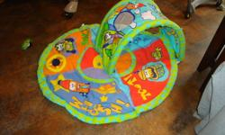 activity mat for tummy time or to practice reaching for objects. There is a little tunnel with a peek a boo hole too. My baby has simply outgrown this item.