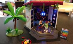Playmobil Dance Floor Resort Lights up and plays music Dance floor flips over to a sorry game board