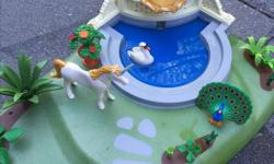 Excellent condition, this fountain really works with water. Includes Unicorn, swan and various accessories