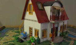 Suburban house with kitchen, living room, children's room, bathroom and nursery. This set is still available in stores and all listed retails for $275.00. In excellent shape.