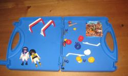 Portable play set comes with carrying case, two sports figurines and numerous sports accessories to dress and play with (baseball hats, bats, skates, hockey nets, hockey sticks, football, football helmets, etc. In excellent condition and from a