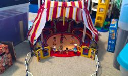 "Full Circus tent in box Excellent condition, all parts included Circus tent, seats surrounding ring, trapeze & 2x trapeze artists, 3x people, other small pieces ""Circus"" archway lights up at back"