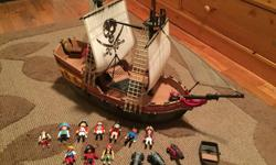 Excellent condition Playmobile Pirate Ship! Comes complete with everything (teaser chests, canons, pirate galley stuff) and comes with pirates and lots of pirate weapons! This is a fantastic quality ship (it's Playmobile) but it's already built so no need