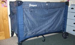 Cosco Funsport playpen and travelling bed. In perfect condition, great for travelling from birth until 18mths. Has a bassinet attachment for newborns which can be removed as the child grows. Also has a side pocket for storage, wheels on one side for easy