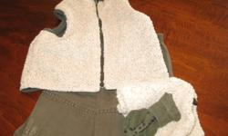 A reversible Vest either Khaki or looking like a Sherpa Fleece Khaki pants with elastic waist the pants have the double knee's Sherpa Fleece Hat and Khaki Socks