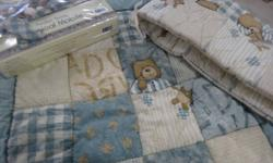 Bedding set fits standard crib & toddler bed mattresses. Great condition - used for 1 child only Comes from a Non-smoking home. Set includes: - 2 crib sheets (1 cotton, 1 flannel) - bumper pads - bedskirt - crib blanket - window valance - musical mobile