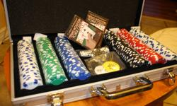 New poker set in case. All chips & cards still in plastic case. Asking $30.00 OBO Email me if interested.