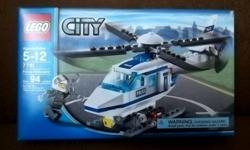 LEGO: Police Helicopter Set.  **Never Opened- in original packaging! 94 pieces Building toy great for ages 5-12 yrs. Set includes *Helicopter *Police pilot. **Comes from a Pet-Free & Smoke-Free Home*