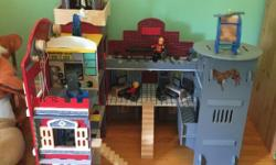 Imagination playhouse - police station and fire house. Comes with all accessories shown. Furniture, two people, helicopter, police car and fire truck Instructions on how to put it together are included
