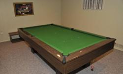 4 x 8 King Edward ¾?slate pool table has brown frame, dark oak rails and leather pockets. Slate comes in 3 pieces. Also included is a Boston ball set, Snooker ball set, score board, cues, cue rest, rack, brush, chalk.  Cover also included.