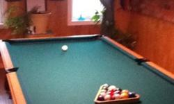4x8 slate pool table. Cues and balls included. This ad was posted with the Kijiji Classifieds app.