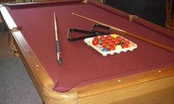We have a connely pool table for sale. It comes with 6 cue sticks, set of 8 balls, set of snooker balls, and 3 balls setters. This table has a 3/4 inch slate, cranberry cloth and is 3 years old.