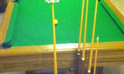 Slate pool table Measures 56? X 100? Includes 2 sets of balls, 4 pool cues, cover and rack. Great Christmas Gift