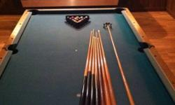 Great non slate pool table. In great overall condition. No tears on the felt and it is fairly flat. It comes complete with two sets of balls, including a snooker set. Also includes a rake and 7 pool cues. Just don't have the room for it any more. $450