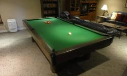Brunswick Covington Pool Table In good condition Cues and two sets of balls included 81/2ft X 41/2 ft  3/4 inch slate $900.00 or best offer