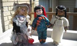 15 1/2 inch high porcelain dolls in very good condition. $5.00 each Perfect for Christmas!