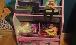 Perfect condition. Two rows of fabric shelves for books and four fabric containers for items.