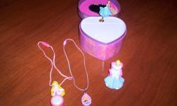 Jewelry Box plays music, both Necklaces lights up and the key chain plays music. All are in excellent working condition.