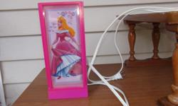 Princess nightlight. It has different princess pictures. Never been use. Any girl will love it