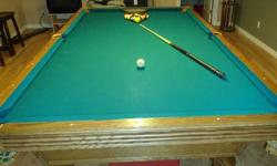 """Top of the line Solid Oak with 1"""" slate and Ball & Claw feet.  Incl. is balls, wooden rack, red dot cue ball 4 cues and granny and leather cover."""