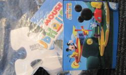 5 puzzles. Dora, Thomas the Tank Engine, Lightning McQueen (2) and Mickey's Club House. Around age 3-5 yrs