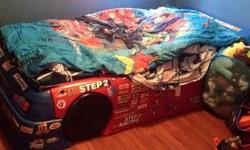 Toddler/twin racecar bed without mattress. Great shape just has a few extra stickers on it. $150 obo.