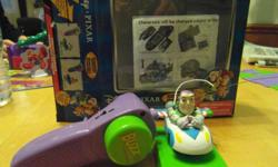 Radio Control Miniature Buzz Lightyear will throw in a small windup Buzz that travels along a track.  You can assemble the track in a variety of shapes.  from my non-smoking, pet free home