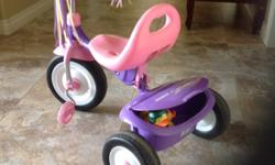 Brightly coloured Radio Flyer Tricycle in excellent condition. At Grandma's house, so not used much. Stored inside. Trunk can be used to haul special items. Located in Lumsden, but I am in Regina a couple times per week for convenient pickup.