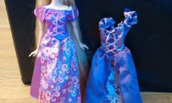 There is two dresses and one doll. All parts of the doll move. Both dresses are different.