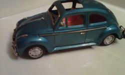 For sale is this awesome RARE and vintage 1960's Bandai made in Japan tin friction powered VW Volkswagen Beetle car.   The car is in great shape with only a minor amount of play wear and is complete minus one wheel cover!  Check the online auctions to see